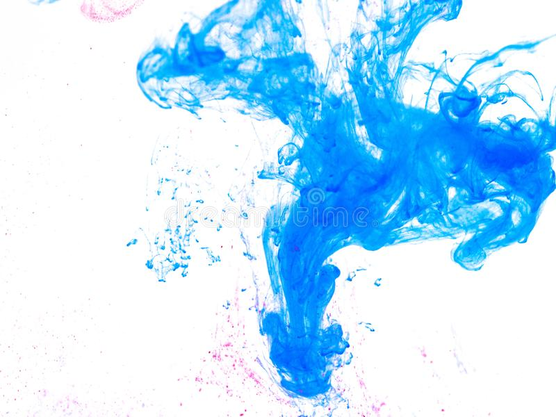 Poster color in water. Abstract background royalty free stock photos