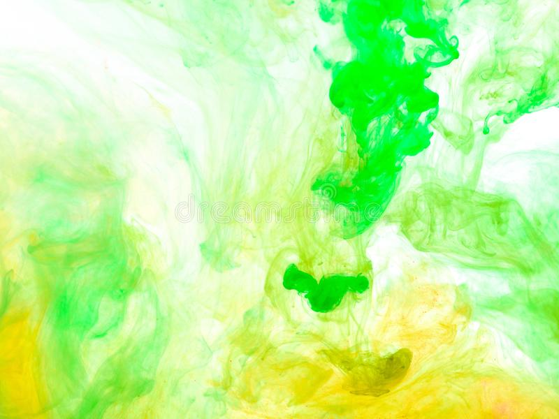 Poster color in water. Abstract background stock photos