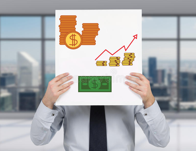 Poster with drawing money. Businessman holding poster with drawing money stock image