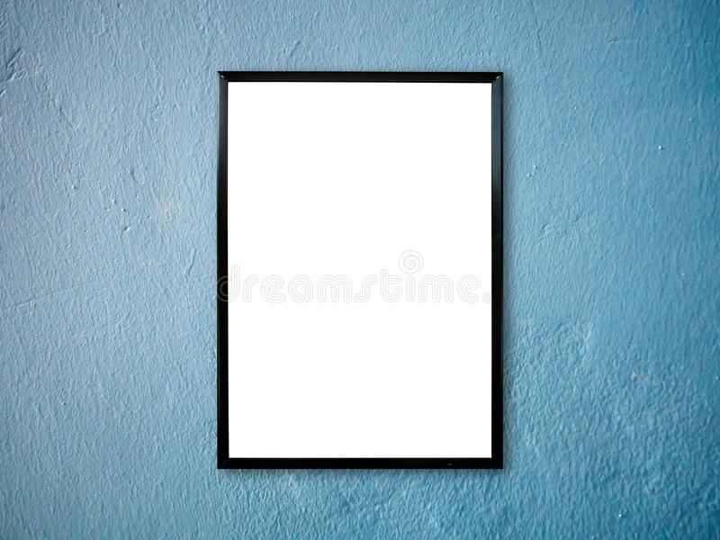 Poster frame on wall. Poster frame on blue paint wall background royalty free stock photo