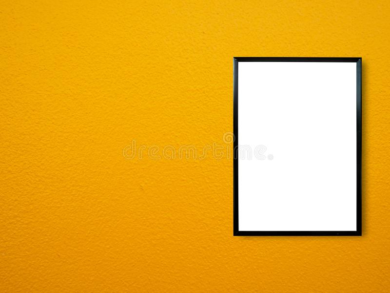 Poster frame on wall. Poster frame on yellow paint wall background stock image