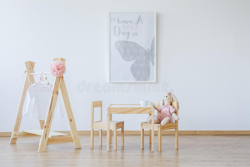 Poster hanging in scandi room royalty free stock photography