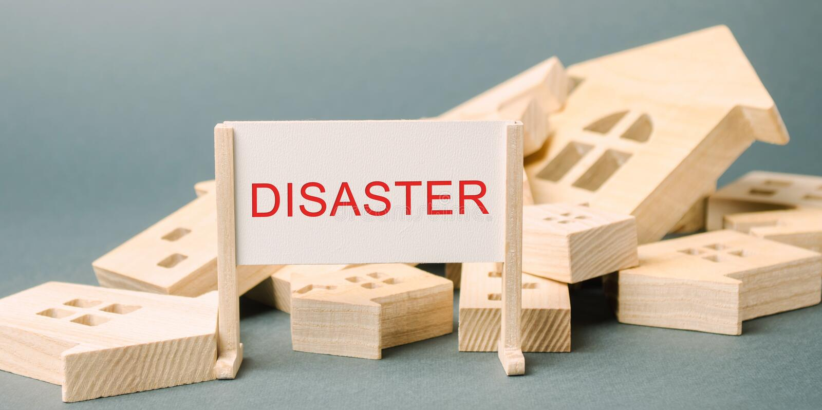 A poster with the inscription Disaster and fallen wooden houses. Urgent evacuation of people. Hurricane. Storm. Fire. Explosion. stock photo