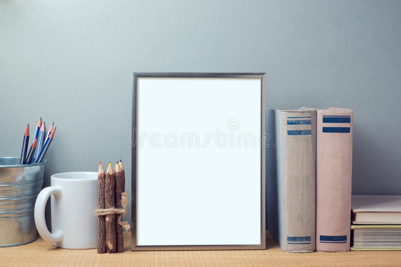 Poster mock up template with books and desk objects royalty free stock photography