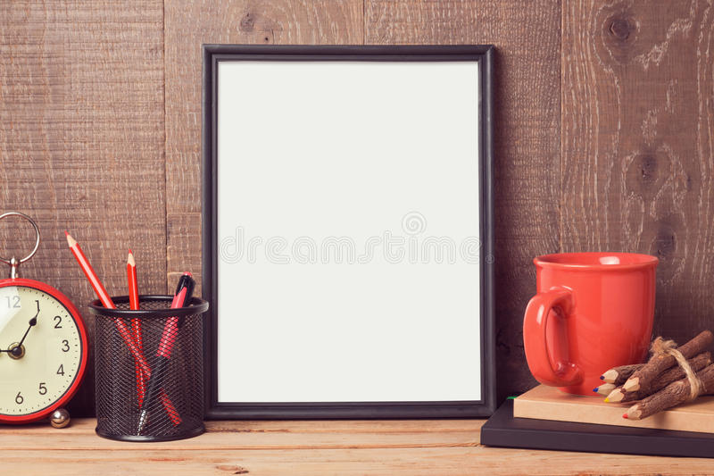 Poster mock up template with business desk objects. Over wooden background royalty free stock image