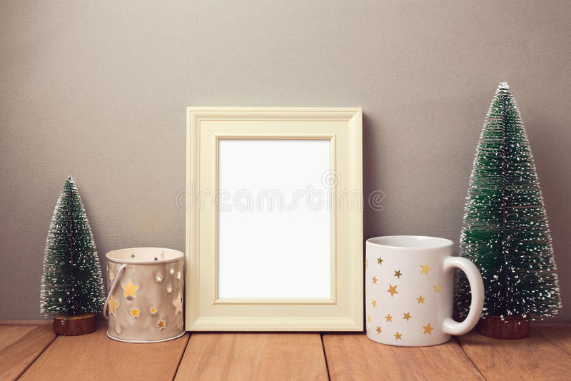 Poster mock up template for Christmas holiday with cup and small pine trees stock image