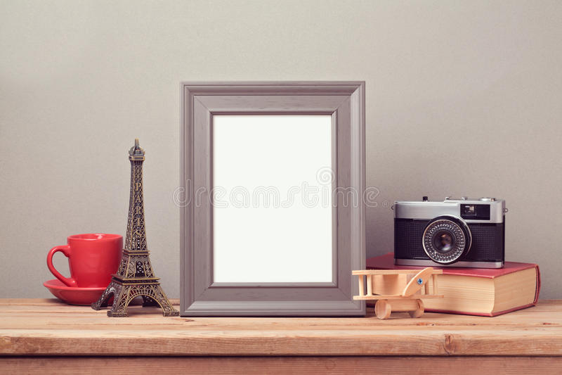 Poster mock up template with Eiffel Tower and vintage film camera. Travel and tourism. Concept stock images