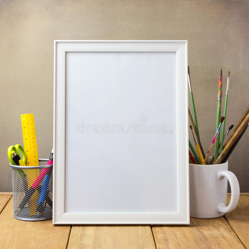 Poster mock up template with office items and painting brushes stock images