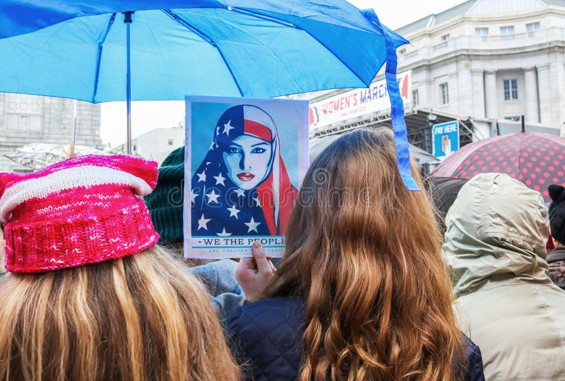 Poster of Muslim American in Crowd at Womens March San Francisco. Taken from crowd at Women`s March in San Francisco, a poster is displayed stock images