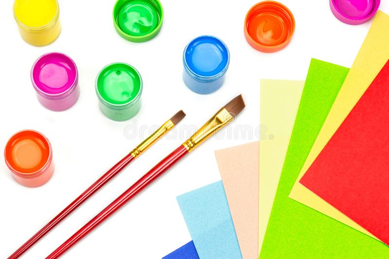 Poster paint color. Multicolor of poster paint color with brush and color papers on white background stock photography