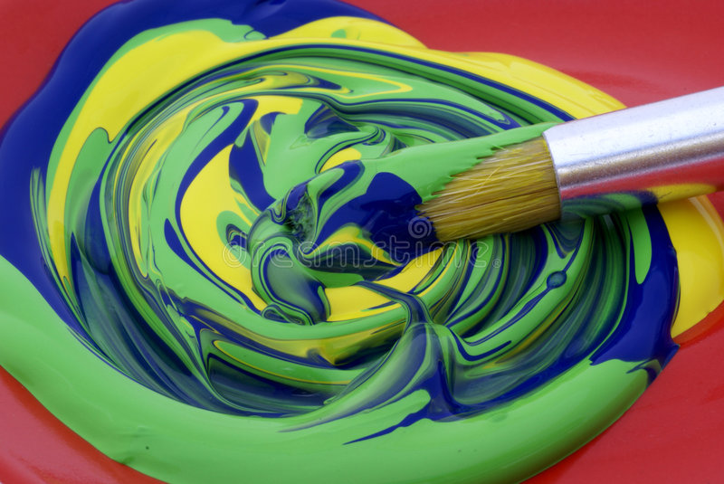 Poster paint, mixed colors. Three colors poster paint with brush stock photos