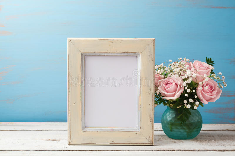 Poster or photo frame mock up template with rose flower bouquet stock photo