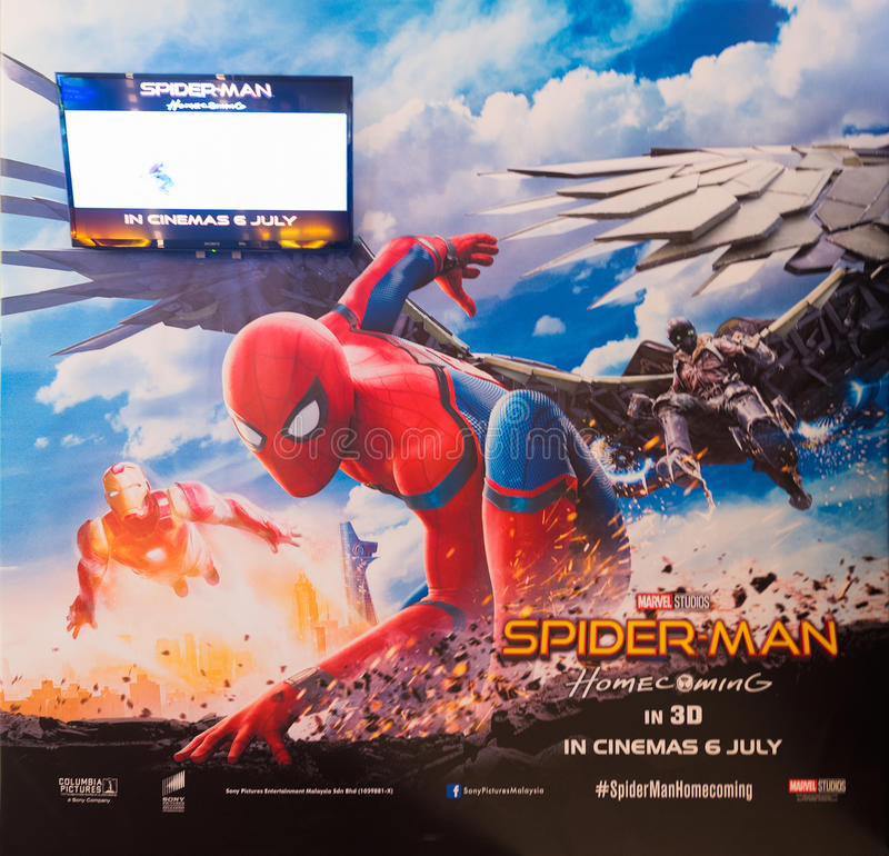 Poster of Spiderman coming soon in Malaysian cinema. KUALA LUMPUR - JUNE 16, 2017: A poster Spiderman Home coming in Pavilion mall movie theater. It is an stock photography