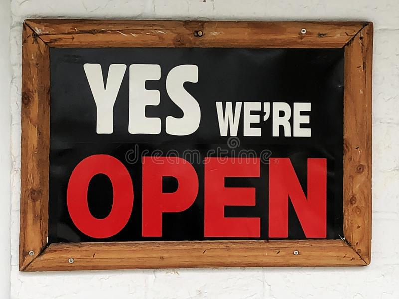 Poster `Yes we`re OPEN` stock photo