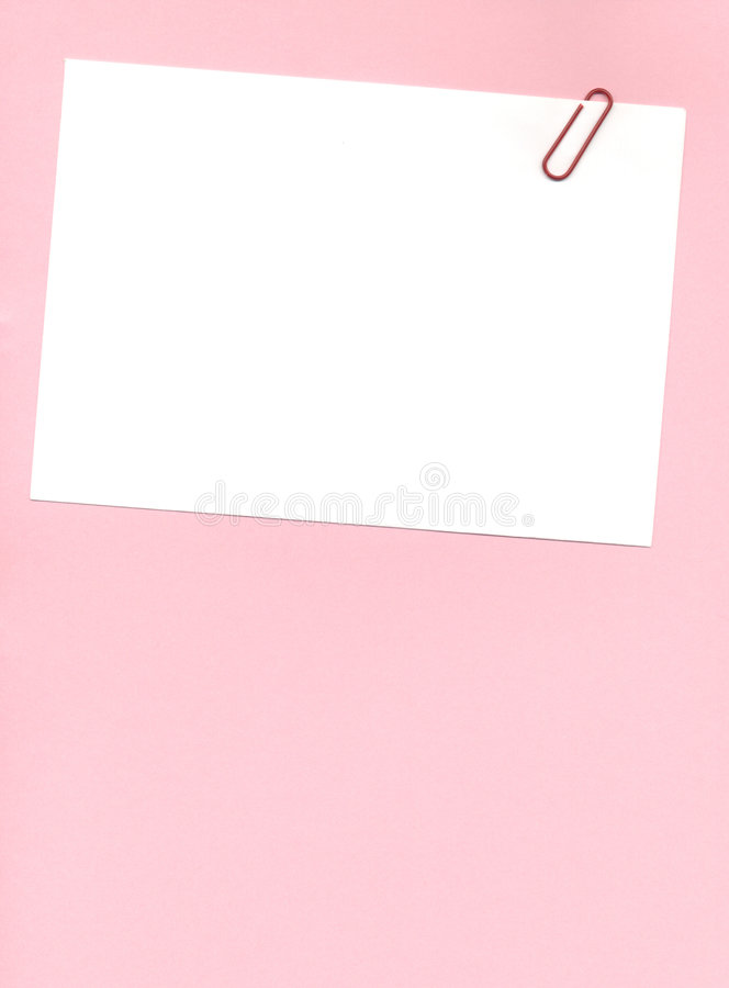 Postit with paperclip. Paperclip on a postit note over a pink background royalty free stock images