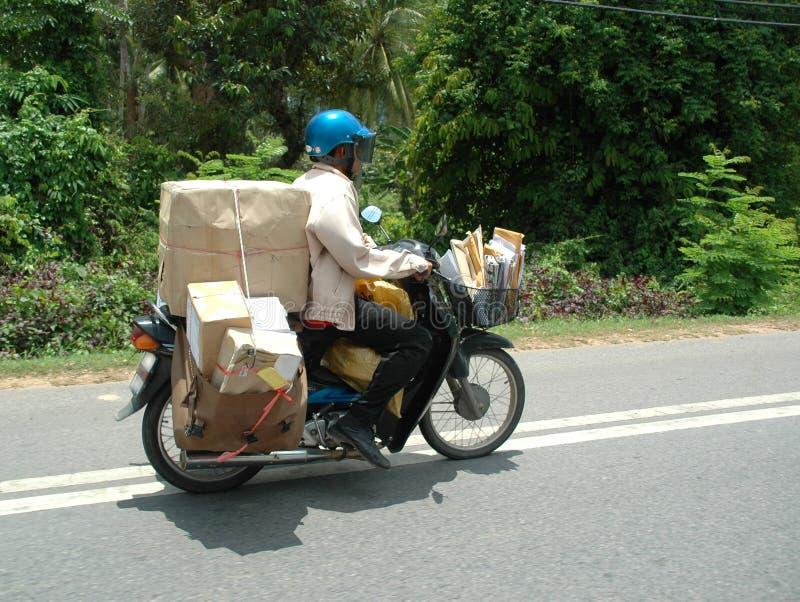Postman. Is driving his motorbike