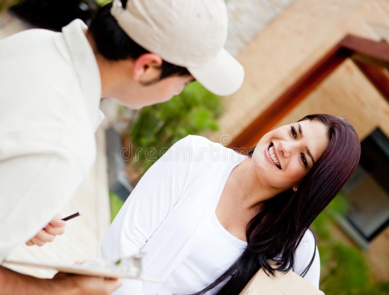 Download Postman Delivering A Package Stock Image - Image: 23972785