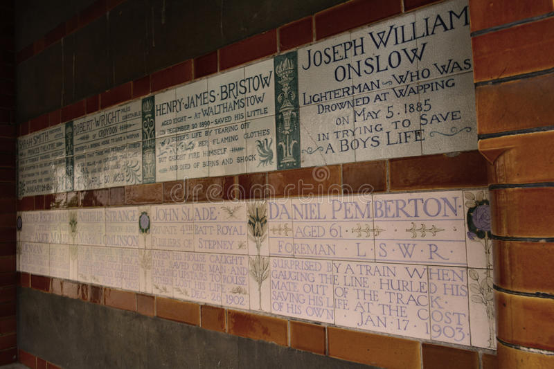 Postman's Park - Memorial to Heroic Self Sacrifice, London, Uk. Postman's Park is a park in central London, a short distance north of St Paul's Cathedral royalty free stock photos