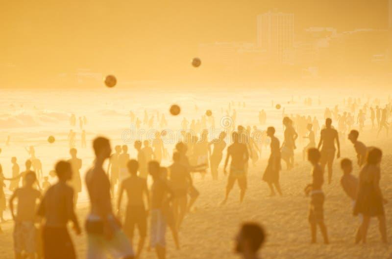 Posto Nove Rio Golden Sunset Silhouettes Beach Football. Posto Nove Rio golden sunset silhouettes of Brazilians playing keepy uppy altinho beach football soccer royalty free stock photos