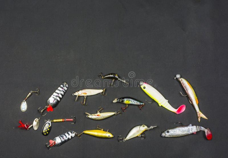Posto per testo accanto ad un'esca artificiale per il pesce immagini stock libere da diritti