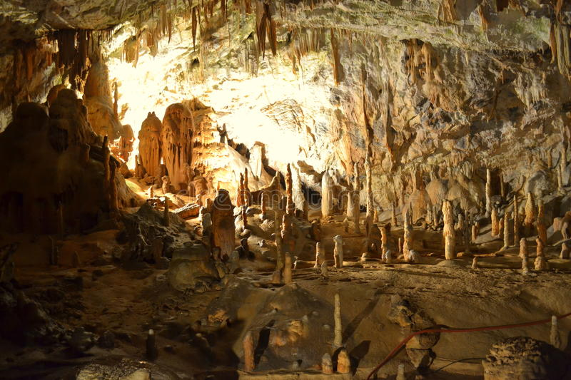 Postojna cave formations. Tourist group exploring Postojna Cave-cave system near Postojna, Slovenia. It is the longest cave system in the country and one of its royalty free stock photo