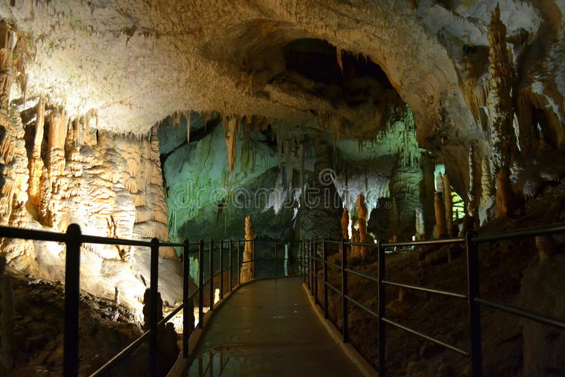 Postojna cave pathway. Pathway for foot passengers in Postojna Cave-cave system near Postojna, Slovenia. It is the longest cave system in the country and one of royalty free stock photos