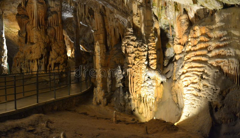 Postojna cave Slovenia. Tourist path in Postojna Cave-cave system near Postojna, Slovenia. It is the longest cave system in the country and one of its top royalty free stock images