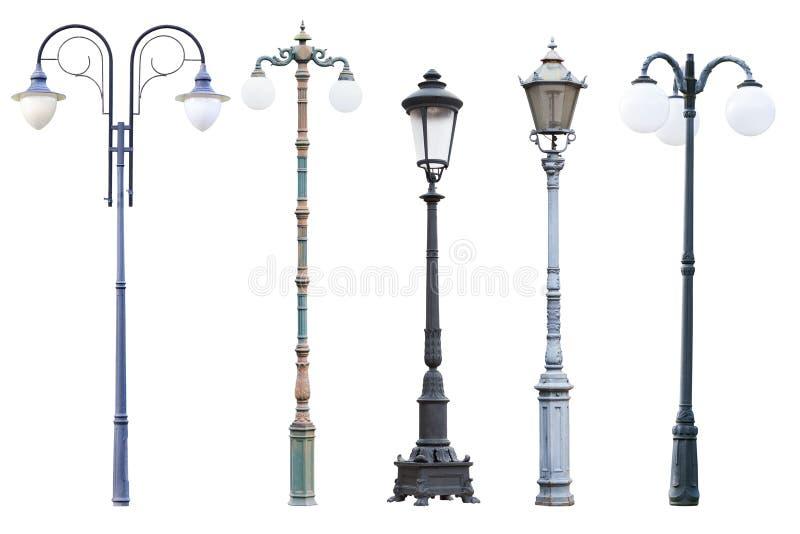 Posts reales y linternas de la lámpara de calle del vintage aislados en los vagos blancos fotografía de archivo libre de regalías