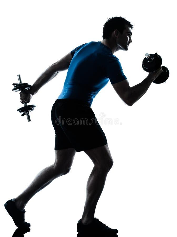 Postura de la aptitud del entrenamiento del peso de ejercicio del hombre imagen de archivo