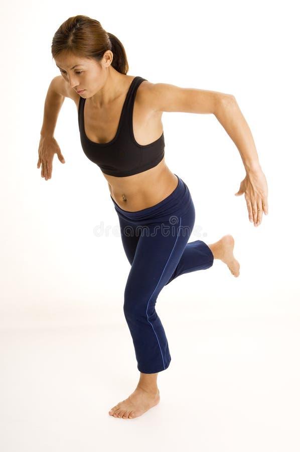 Posture accroupie unijambiste 1 images stock