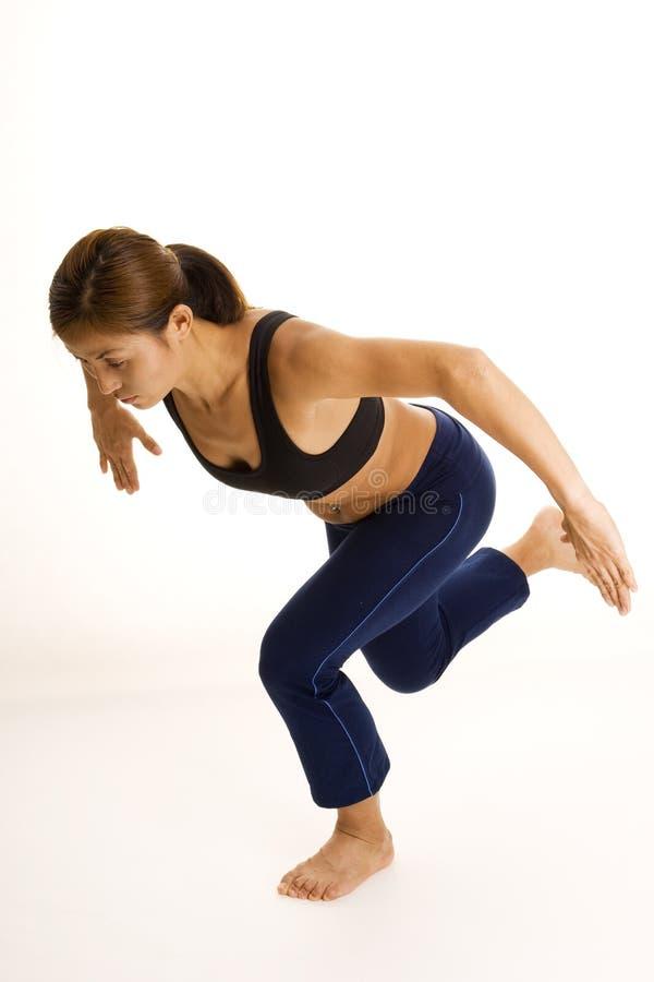 Posture accroupie unijambiste 2 photos stock