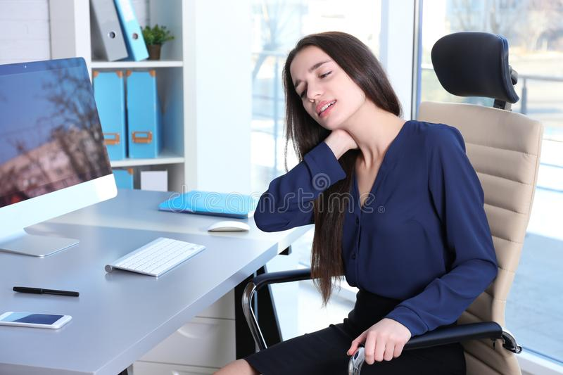 Posture concept. Young woman suffering royalty free stock photos