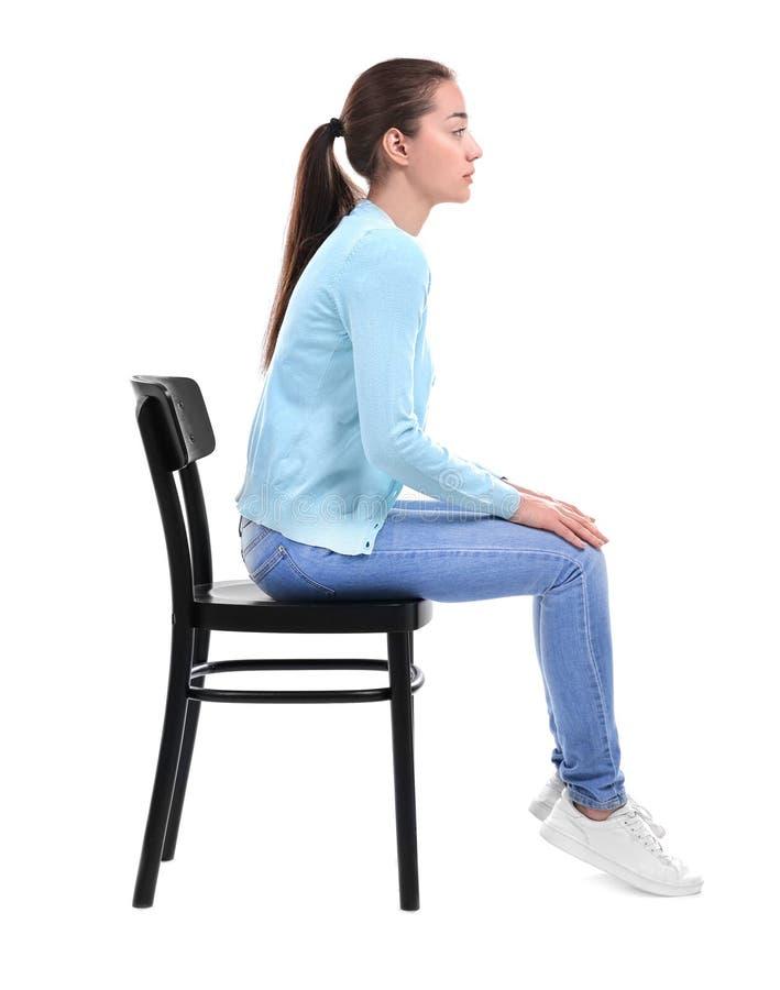 Postury pojęcie kobieta siedzi młody krzesło obrazy stock