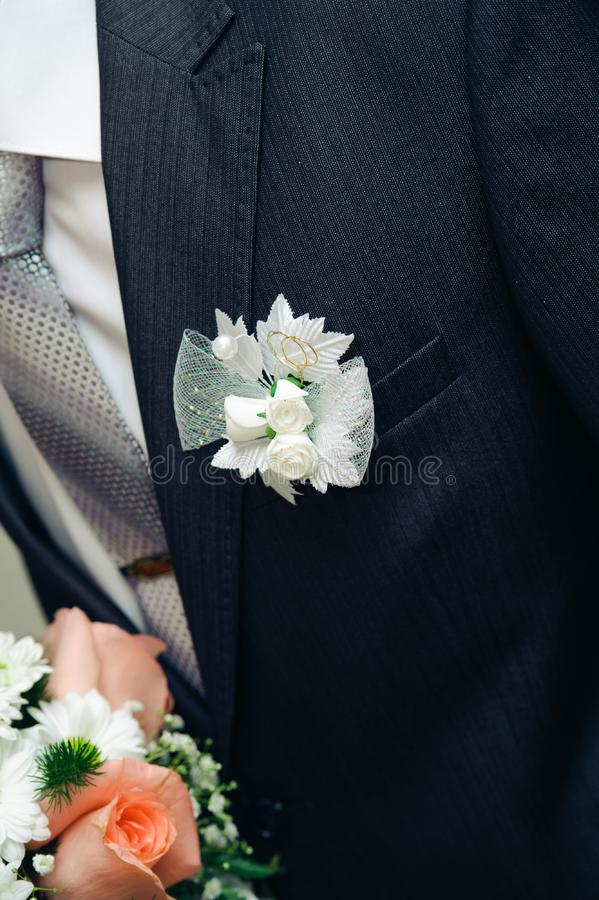Download Posy With Roses On Groom Suit Stock Photo - Image of buttonhole, decorate: 23300658