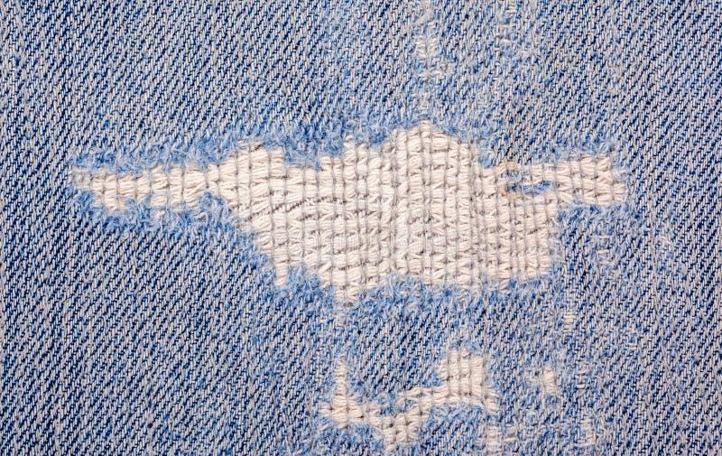 Poszarpana stara niebiescy dżinsy tekstura obraz stock