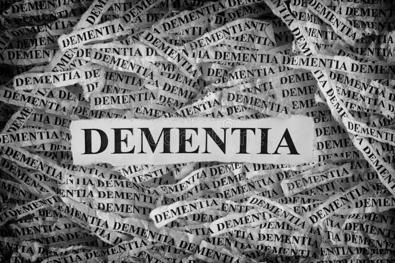 Poszarpani kawałki papieru z słowo demencją zdjęcia royalty free