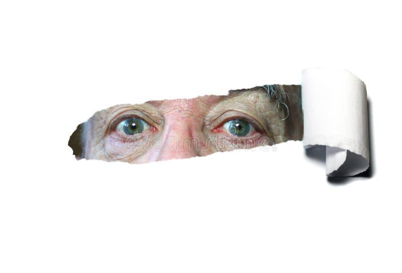 Poszarpani papierowi wyjawia oczy. fotografia stock