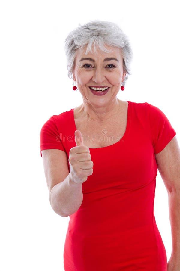 Potężna i pomyślna stara kobieta - aprobaty odizolowywać. zdjęcia stock