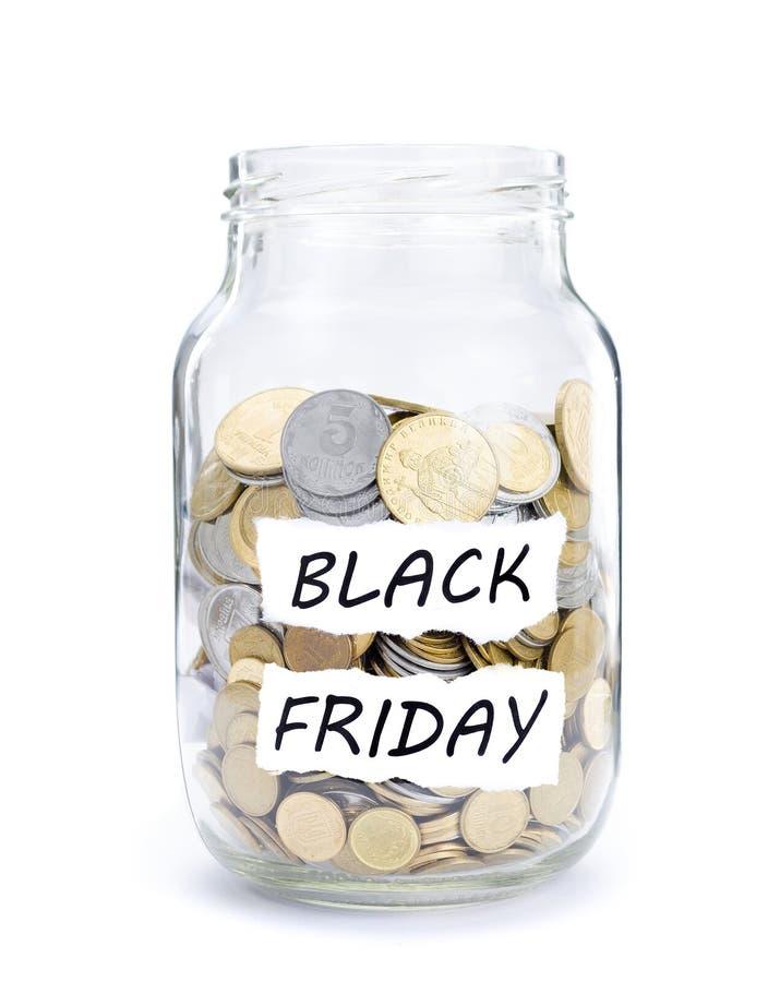 Pot avec des pièces de monnaie sur Black Friday photo stock
