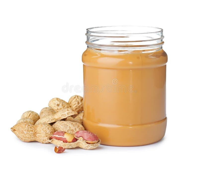 Pot avec le beurre d'arachide crémeux photos stock