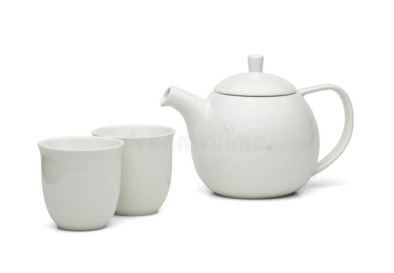 Pot blanc de thé avec des tasses de thé réglées image libre de droits
