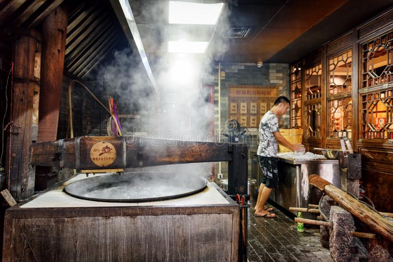 Pot of boiling water in kitchen of traditional restaurant, China stock image
