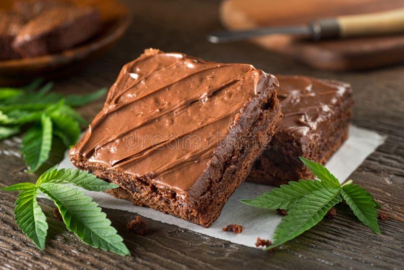 Pot Brownies. Delicious homemade pot brownies with marijuana leaf garnish royalty free stock photos