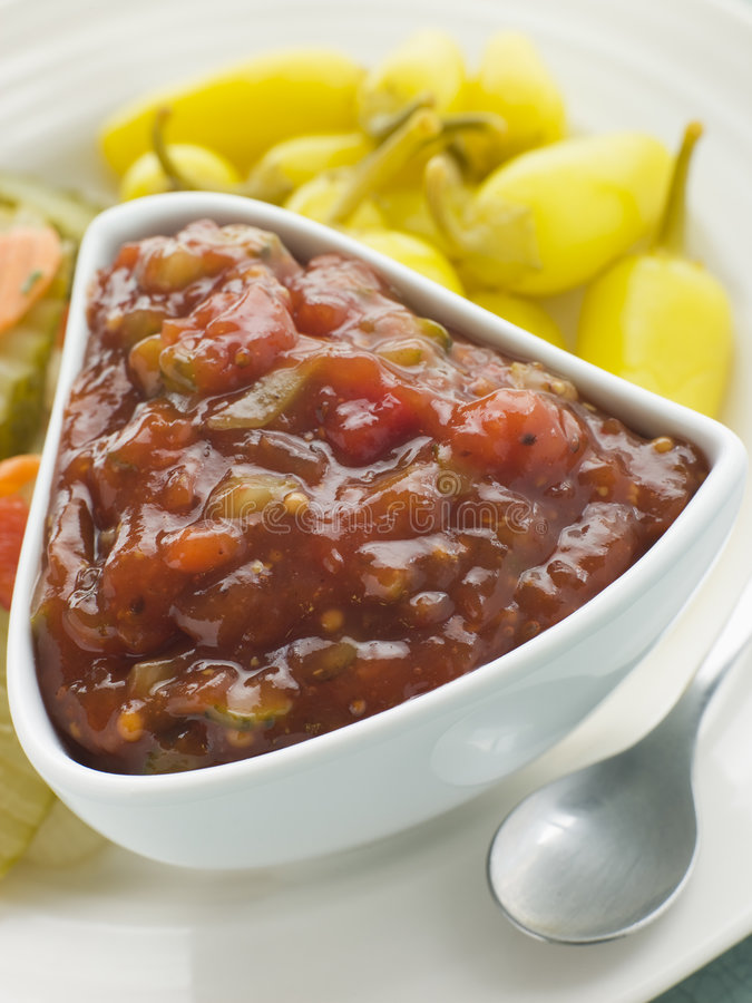 Pot of Burger Relish with Pickled Chillies royalty free stock images