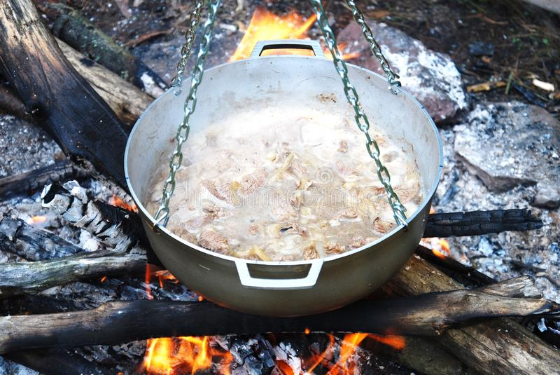 Pot with cooking beef stock photography