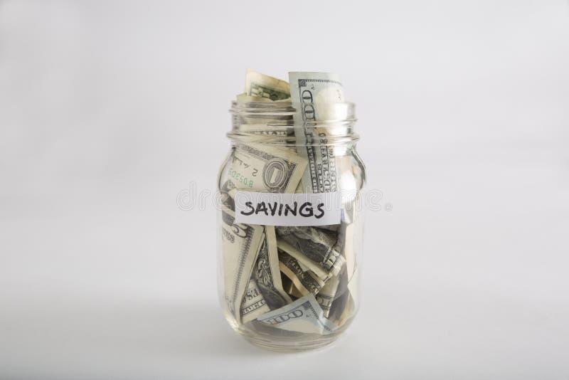 Pot de maçon avec l'argent pour l'épargne images stock