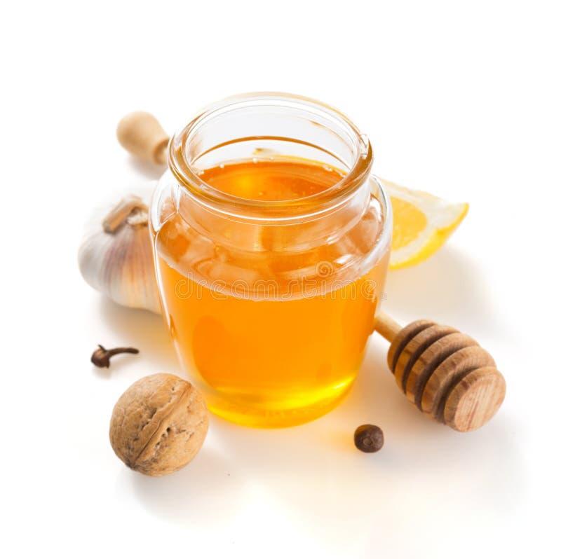 Pot de miel sur le fond blanc images libres de droits