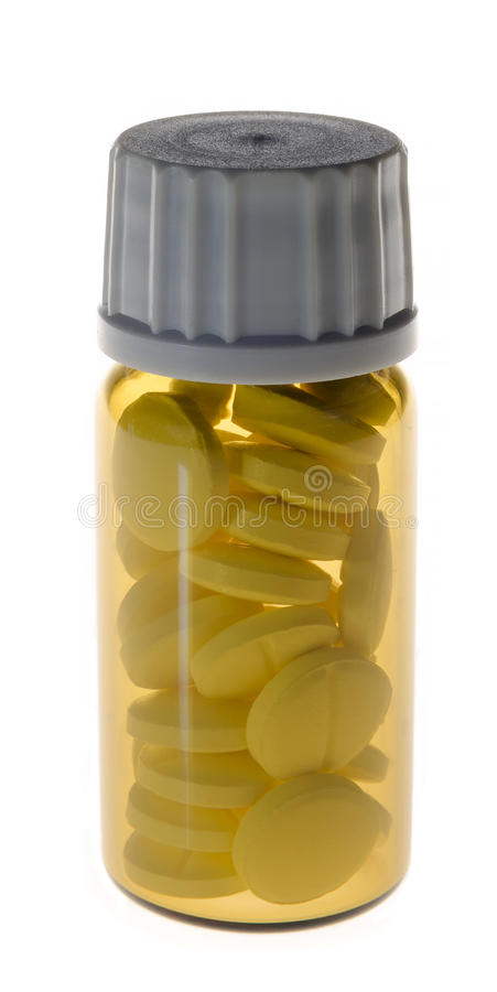 Pot en verre fermé avec les pilules jaunes à l'intérieur photographie stock