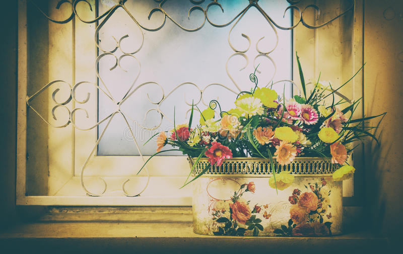 Pot of flowers on the window stock images