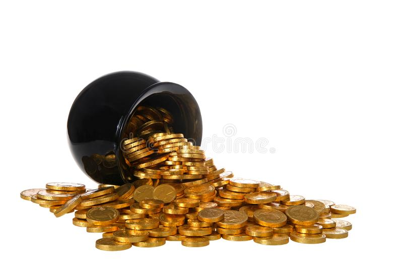 Pot of gold coins spilling over onto white background isolated. Pot of gold filled with gold coins spilling over onto white surface, isolated on white background royalty free stock photography